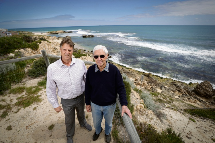 Mike Deephouse (Trigg Surf Lifesaving Club) with Don Floyd whose father drowned while trying to rescue nuns at Trigg. Picture: Andrew Ritchie d474906