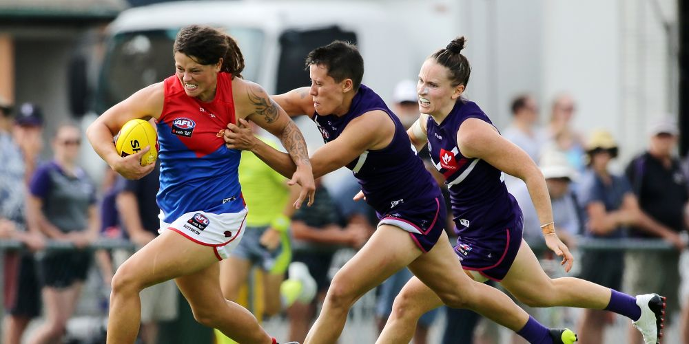 Richelle Cranston is tackled by Fremantle's Evangeline Gooch during the round three AFLW match between the Dockers and Melbourne this afternoon. Picture: Will Russell/Stringer