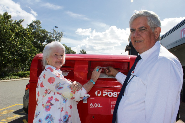 Kathleen Vermeer with Ken Wyatt and the new letter box at Wattle Grove Shopping Centre. Picture: Supplied
