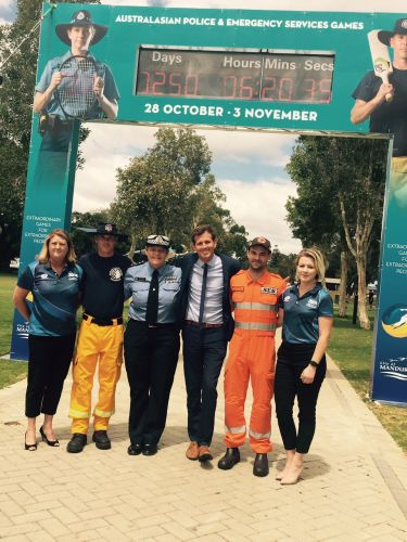 Games organiser Dianne Finlay, volunteer firefighter James Foster, Kerry French from WA Police, Mandurah Mayor Rhys Williams, Matt Marstall from Mandurah SES and organiser Charlie Lennon under the countdown clock.
