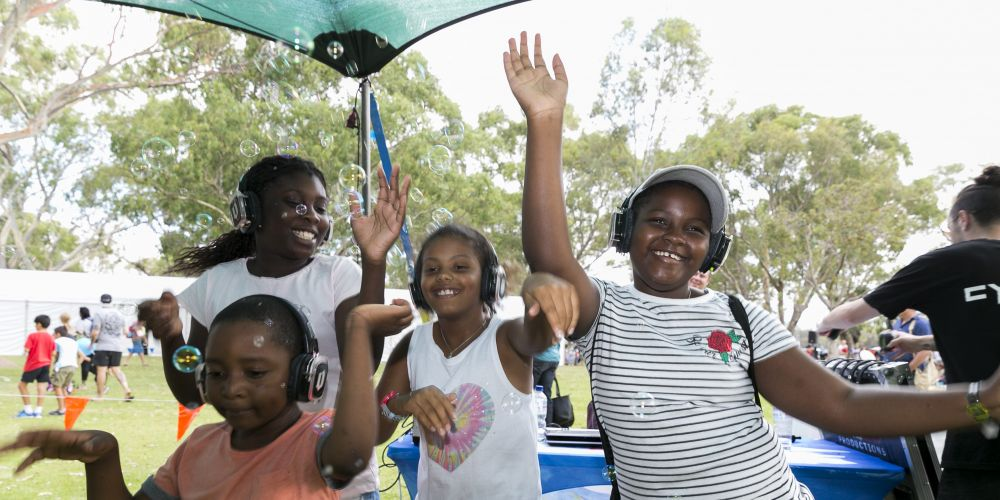 Grooving at the silent disco Alim Sesay, Phillipa Mensaray, Millicent Mcrorie and Rosamond Korora. Picture: Supplied