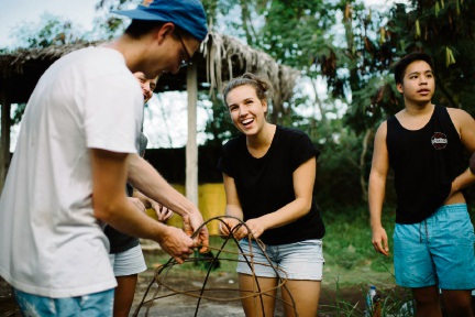 Lauren Peck (centre) playing an active role in the four-week Sustainable Community Development exchange program. Picture: Jillian McHugh Photography