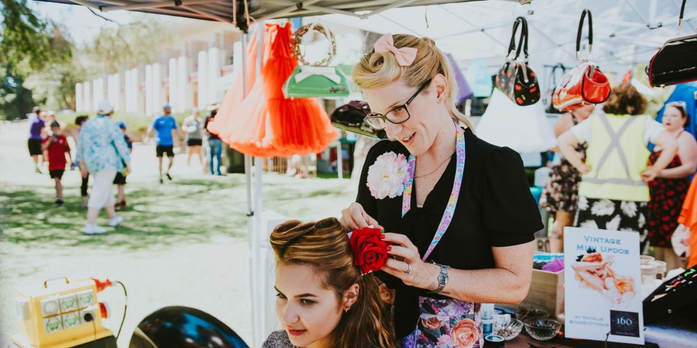 Natalie from One Sixty Hair working her retro updo magic at last year's Retro Rewind.
