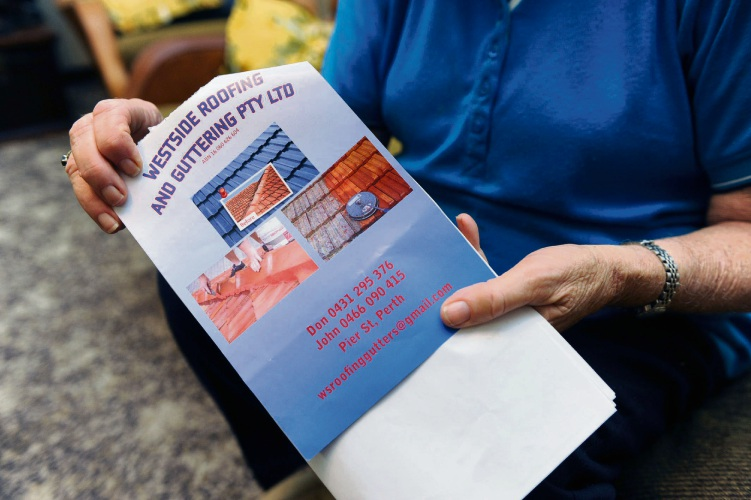 Margaret Baldwin holds the leaflet from tradesmen suspected of scamming $3000 from her.  Picture: Jon Bassett.