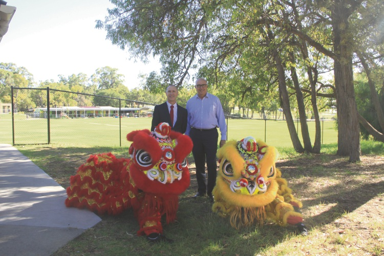 Calista Primary School principal Craig Skinner with Tianqi Lithium's general manager Phil Thick and Lion dancers from Chow Kwoon Yarn Yee Tong Kung Fu Academy.