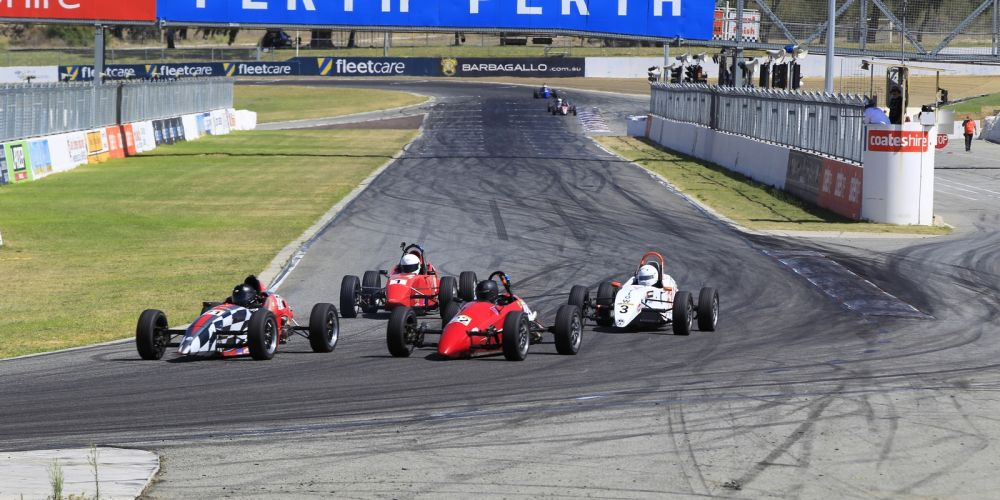 Formula Vees winner Austin Pearson (white car) who won from Rod Lisson (#71). Picture: Barnsiesphotos