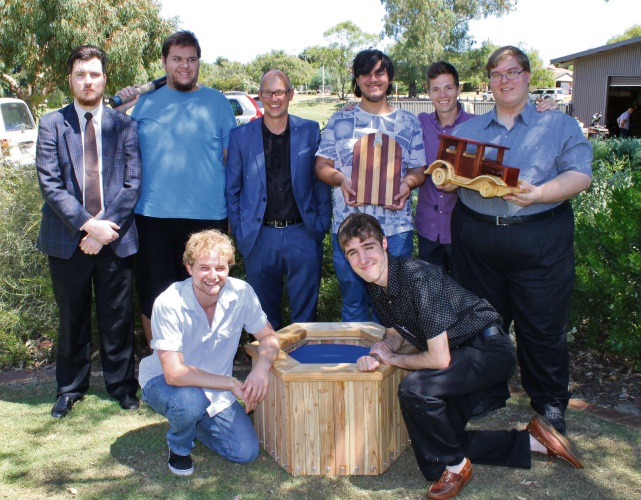 Curtin University's Dr Ben Milbourn (suit) and Ciarain Hoey (purple shirt) with mentees (back left to right, then front left to right), Mathew McWhirter, James McMahon, Jamie Clements, Declan Prince, Sebastian Brown and James Mincham.