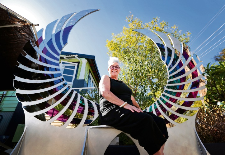 Mixed media sculptor Denise Pepper of Bayswater with her Sculpture by the Sea entry in the shape of wings. Picture: David Baylis www.communitypix.com.au d479679