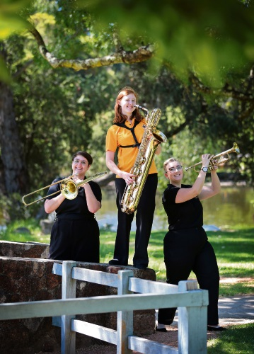 Laura Clark of Gosnells on baritone sax, Lola Sterrett of Rivervale on trombone and Anna Halligan of Edgewater on trumpet. The Kalamunda Swing Band regularly plays at Stirk Park in Kalamunda. Picture: David Baylis.