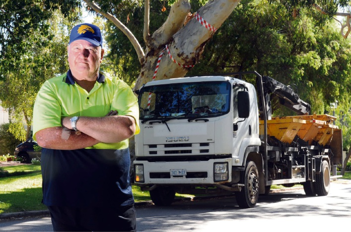Truckie Peter Plaisted is still unhappy the leaning tree of Riley Road has been kept.  Picture: Jon Bassett