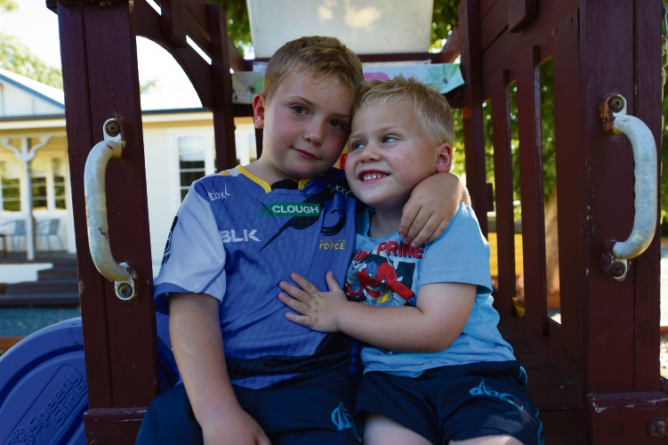 Finnley Regler (6) with his brother Israel, who he rescued from drowning. Picture: Jon Hewson.
