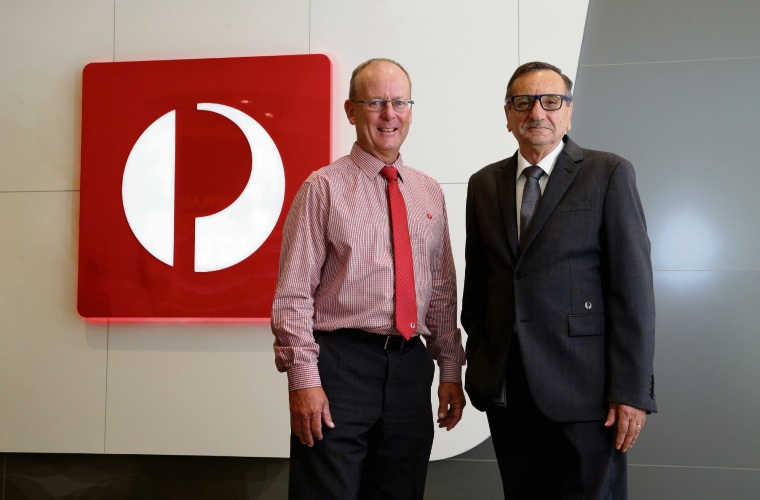 Scott Graham and Fred Cimmino are celebrating 30 years at Australia Post after starting at the organisation on the same day.