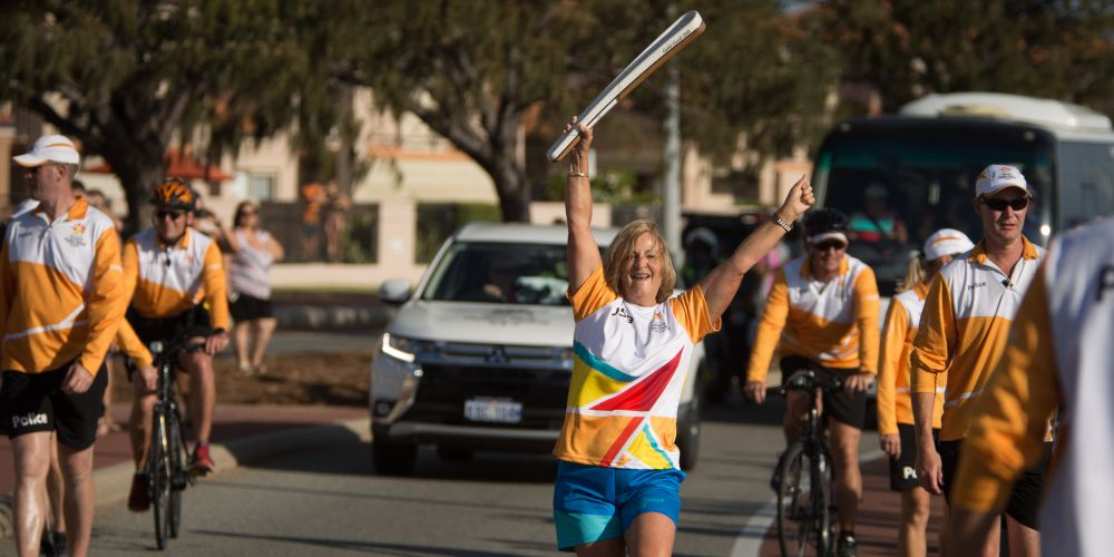 The Queen's Baton, carried by batonbearer Christine Cougan, in relay along the coast through Hillarys, on February 25.