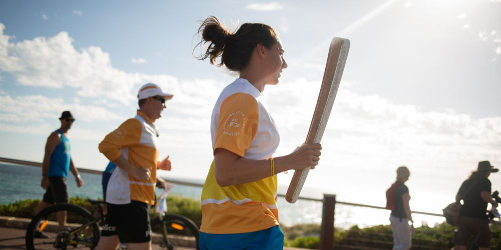 The Queen's Baton, carried by batonbearer Allison Nankivell on West Coast Drive.