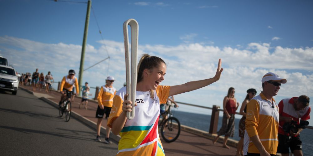 The Queen's Baton, carried by batonbearer Asha Rojahn, in Marmion.