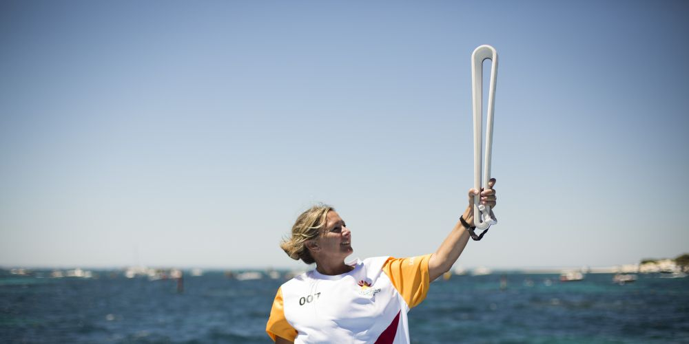 Batonbearer Kellie Properjohn carrying the Baton on board a police vessel as the Queen's Baton Relay travelled from Rottnest Island to Fremantle.