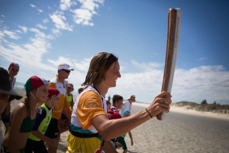 Kite surfer Mani Bisschops (17) flanked by Scarborough SLSC nippers.