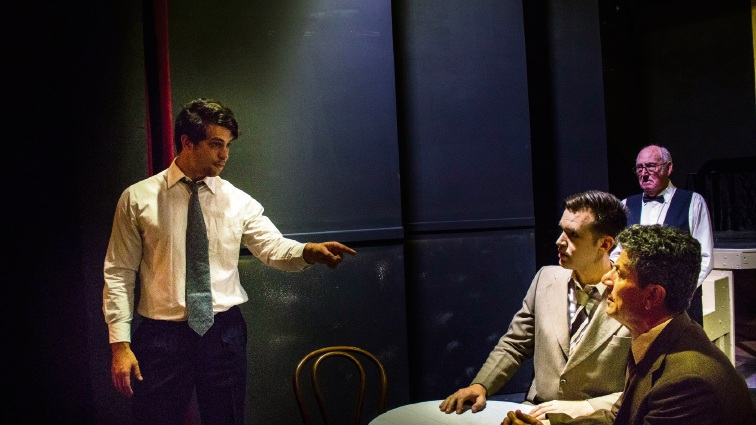 Biff (Daniel Moxham) makes a point to Happy (Jason Wall) and Willy (Sorrento resident Gino Cataldo) in Death of a Salesman as the waiter (Patrick McLanaghan) looks on. Picture: Daniel Ade