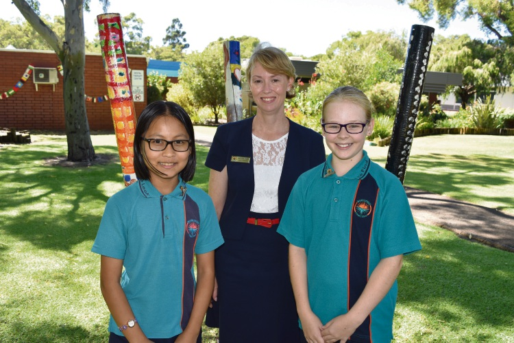 Warriapendi Primary School head students Paw Tha Sue Htoo and Jorja de Rosario with co-principal Natasha Doyle (centre).