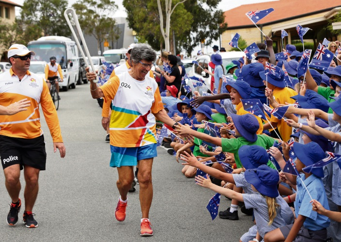 Queen's Baton Relay baton bearer Gaye Teede with St Anthony's School students. Picture: Martin Kennealey www.communitypix.com.au d479831