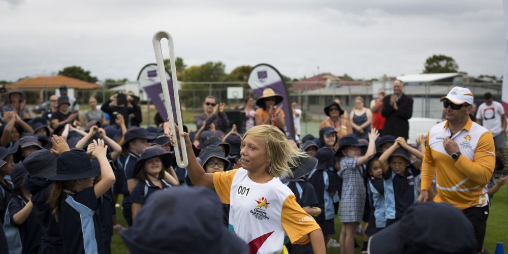 Batonbearer Jackson Anderson carrying the Baton from Quinns Beach Primary School as the Queen's Baton Relay Visited Quinns Rocks. Picture: Supplied