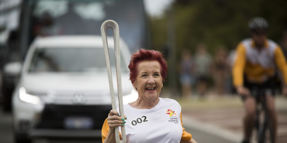 Batonbearer Rusty Hazel carrying the Baton as the Queen's Baton Relay visited Quinns Rocks. Picture: Supplied