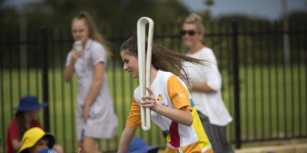Baton bearer Katie Robertson carrying the Baton as the Queen's Baton Relay visited Quinns Rocks. Picture: Supplied