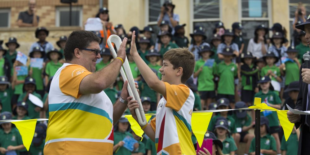 Baton bearer Scott Guerini (left) passing the baton to Anthony Shields at Peter Moyes Anglican Community School as the Queen's Baton Relay. Picture: Supplied