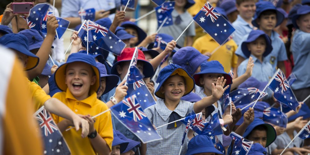 School pupils by the road side watching the Queen's Baton Relay in Wanneroo.  Picture: Supplied