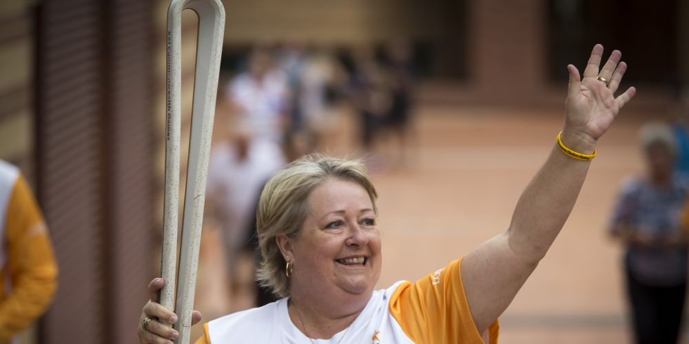Baton bearer Pamela McKenzie carrying the baton. Picture: Supplied