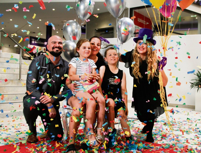Cockburn ARC manager Brett McEwin (left) and Cockburn ARC member relations team leader Rebecca Harrison (right) celebrate with Lisa Gibson and her children Harriet (6) and Alex (8) Bloodworth. Picture: City of Cockburn/Paul McGovern