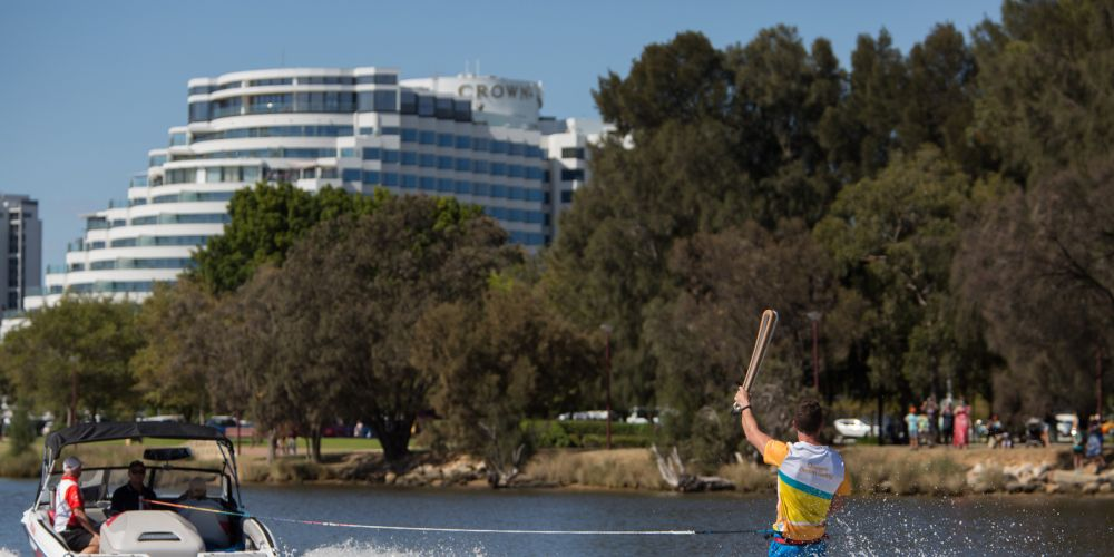 The Queen's Baton, carried by batonbearer Ryan Green on water skis, in relay through South Perth.