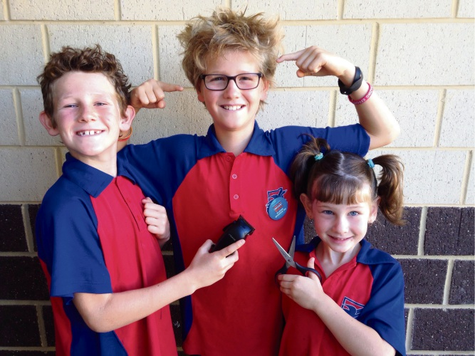 Upper Swan Primary School students Declan Harris (8), Lincoln Harris (9) and McKenzy Harris (6) are fundraising for the World's Greatest Shave on March 15. Picture: Lincoln Harris