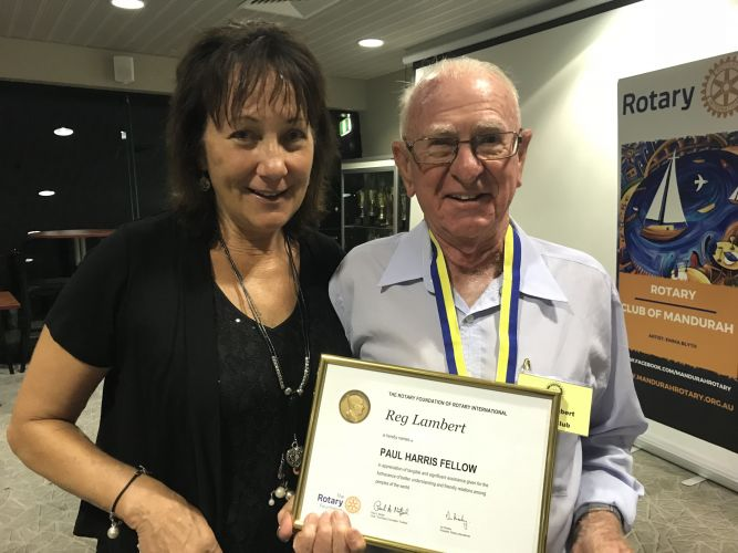 Rotary Club of Mandurah president Marg Pantall awards Reg Lambert with the Paul Harris Fellow Award.