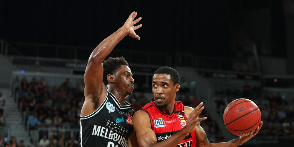 Bryce Cotton of the Wildcats (R) drives at the basket against Melbourne United. Picture: Graham Denholm/Getty Images