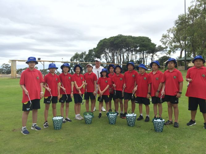 The visiting students with PGA golf professional John Ince.