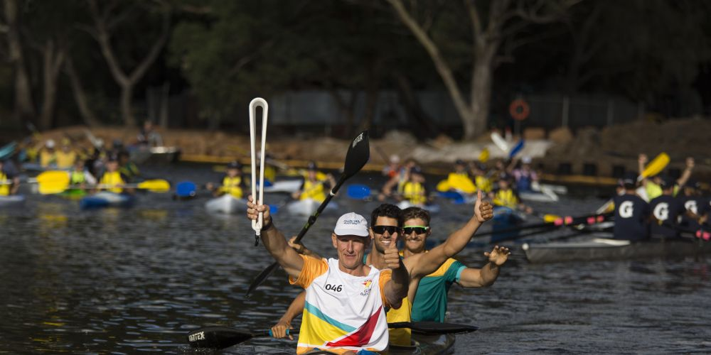 Baton bearer Ramon Andersson carrying the baton in a kayak on the Swan River as the Queen's Baton Relay visited Guildford.  Pictures: Supplied