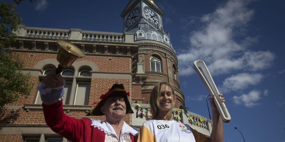 Midland town crier Jay Walsh with baton bearer Natalie Medhurst.