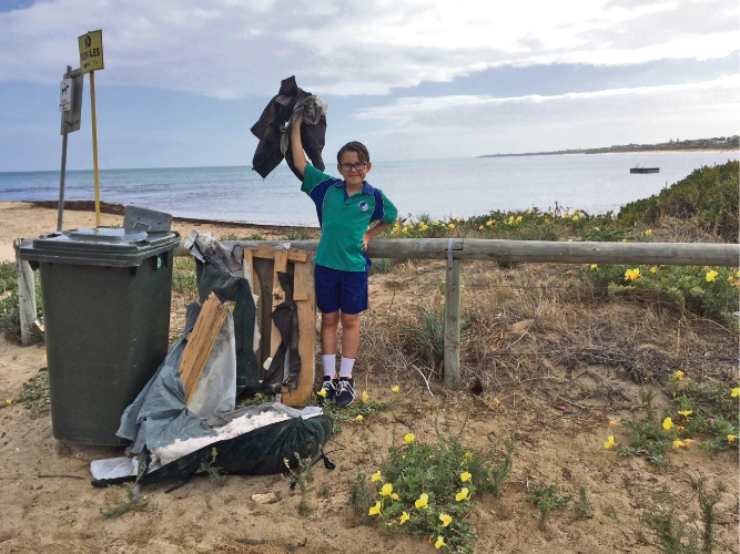Daniel Ingram with some of the rubbish he has removed from the beach.