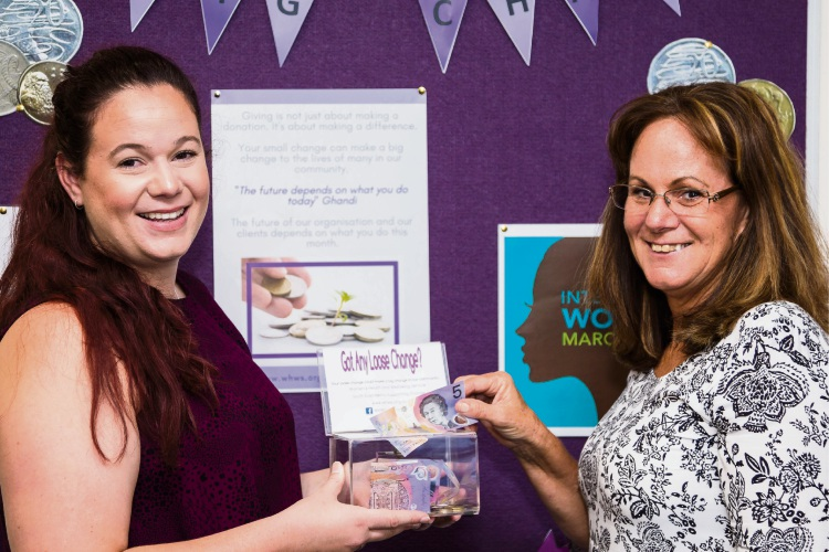 Hannah and Carol Pin of the Women's Health and Wellbeing Services do their part for the Spare Change for Big Change fundraiser.