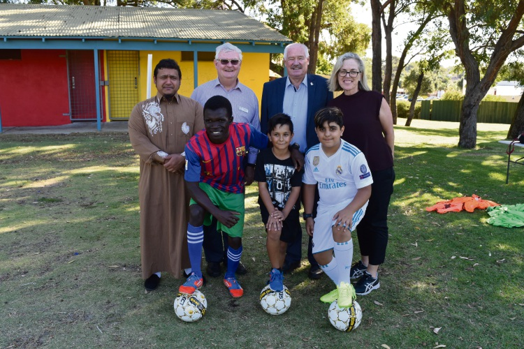 Back row: Imam Mirrabooka Mosque Mohammad Davids, Edmund Rice Centre director Stephen Bowan, Sport and Recreation Minister Mick Murray, Mirrabooka MLA Janine Freeman; Front row: Common Goal players Mizeredi Sino, Seth Lumanovski, Sam Yousefian.