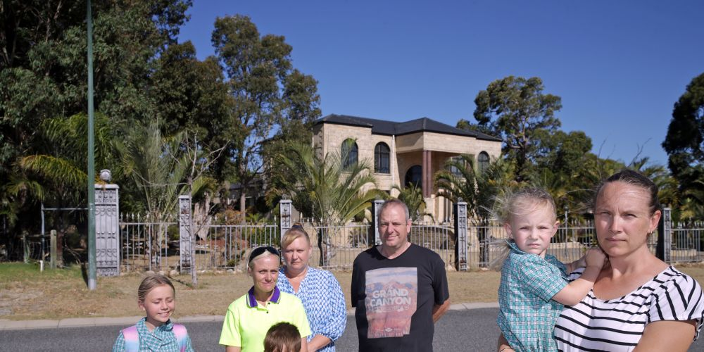 Landsdale residents Joanne Allan with Indy (10) and Jonny (7), Kim Kustra, John Pellegrini and Natalie Herridge and Hannah (4) want lower density development. Picture: Martin Kennealey d480207