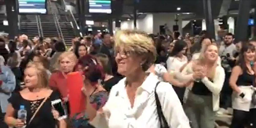 Ed Sheeran fan pulled away by security