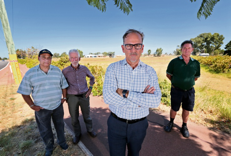 Business owner Geoff  D'Cruz with Brian Hunt, Grant Brinklow and orchardist Harry Gratte.  Picture: David Baylis d480118