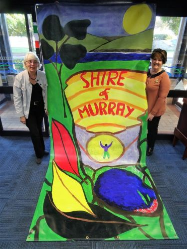 Banners in the Terrace 2017 winner Brenda Beacham and then shire president Maree Reid with the banner.