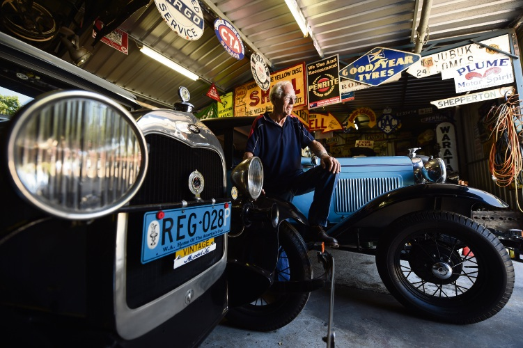 East Victoria Park resident Reg Blewett hangs out with his classic cars in his garage.
