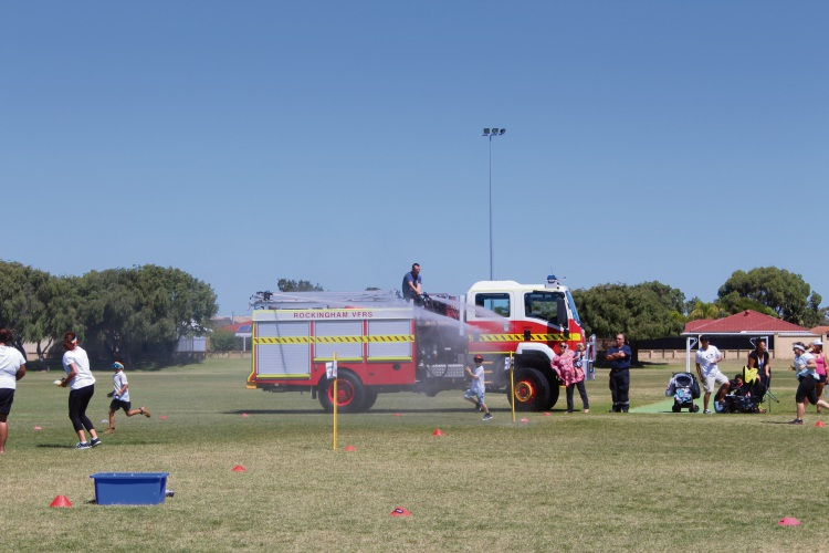 The Fire Brigade was on hand to hose the students down during the fundraising colour run.