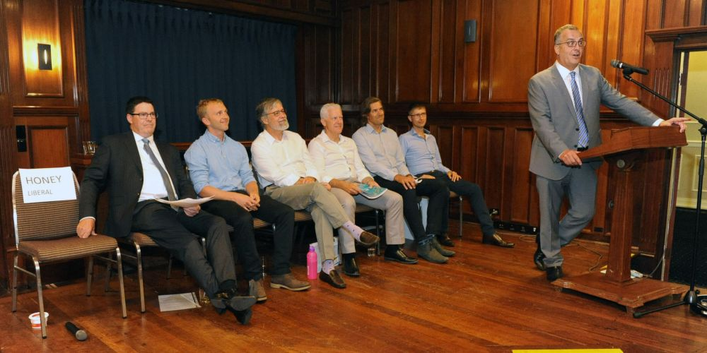 Liberal candidate David Honey's seat (left) was vacant at the Cottesloe by-election forum attended by (l-r) the Micro Business Party's Cam Tinley, cycling independent Michael Thomas, WA Party's Ron Norris, Green Greg Boland, and independents Michael Tucak and Dimitry Malov, mediated by lawyer John Hammond. Picture Jon Bassett