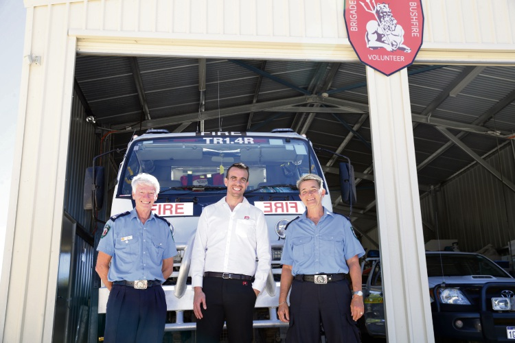 Derek Young and Cora Babenschneider from Two Rocks Volunteer Bush Fire Brigade with Kyle Salomone from Joondalup P&N Bank. Picture: Martin Kennealey d480060