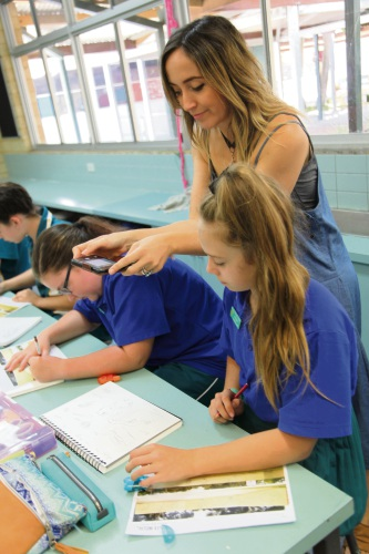 Year 6 Joondalup Primary School students develop their ideas with artist Hayley Welsh.